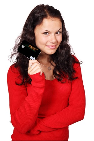 Photo of female holding a Glass City Federal Credit Union Debit Card
