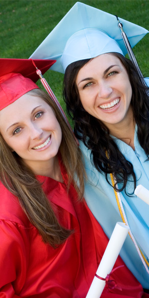 Photo of two students in their cap and gowns