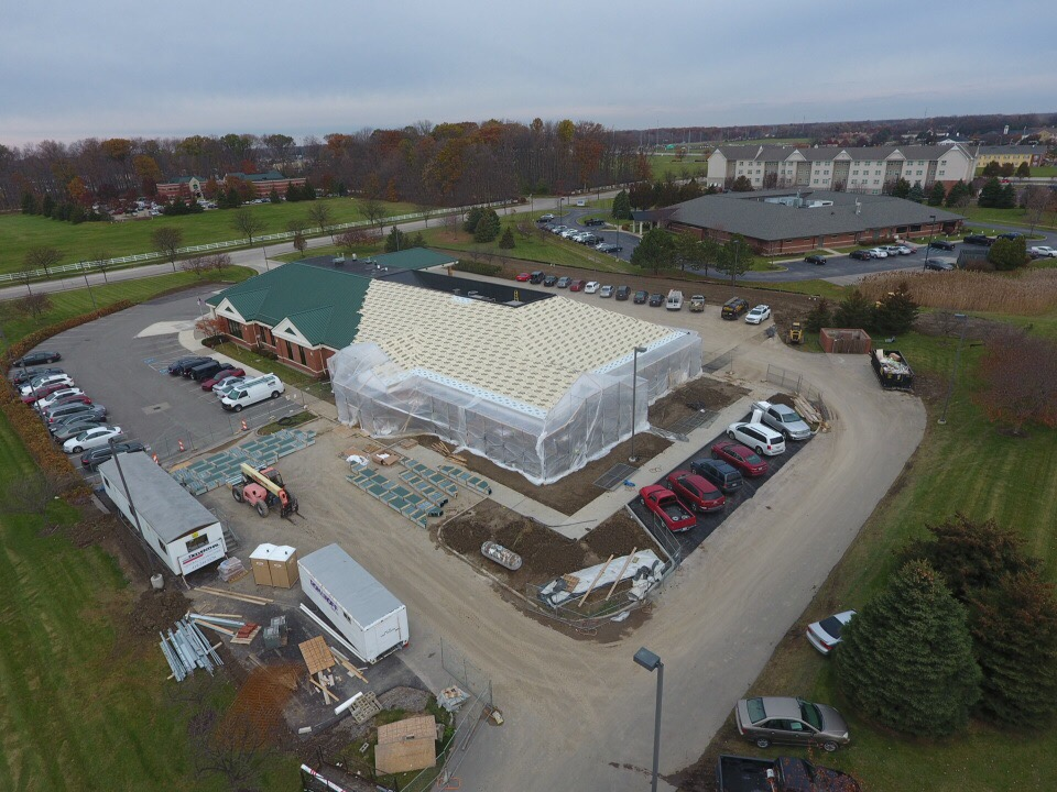 Aerial view of Glass City's Maumee Branch Location under construction with the new roof partially completed